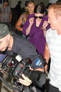 http://img186.imagevenue.com/loc101/th_44193_Anne_Hathaway_arriving_in_Sydney6_122_101lo.jpg