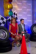 Hoda Kotb on Today show in a short red skirt riding a tricycle